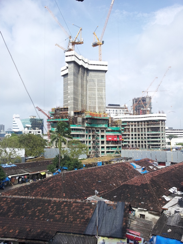 Photo of World One skyscraper under construction as seen from the roofs nearby