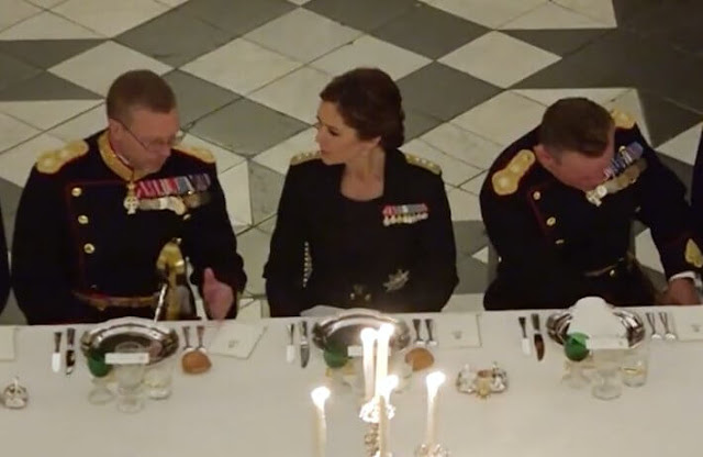 Crown Princess Mary wore the official uniform worn by Danish female navy officers. Queen Margrethe wore a lace tulle gown