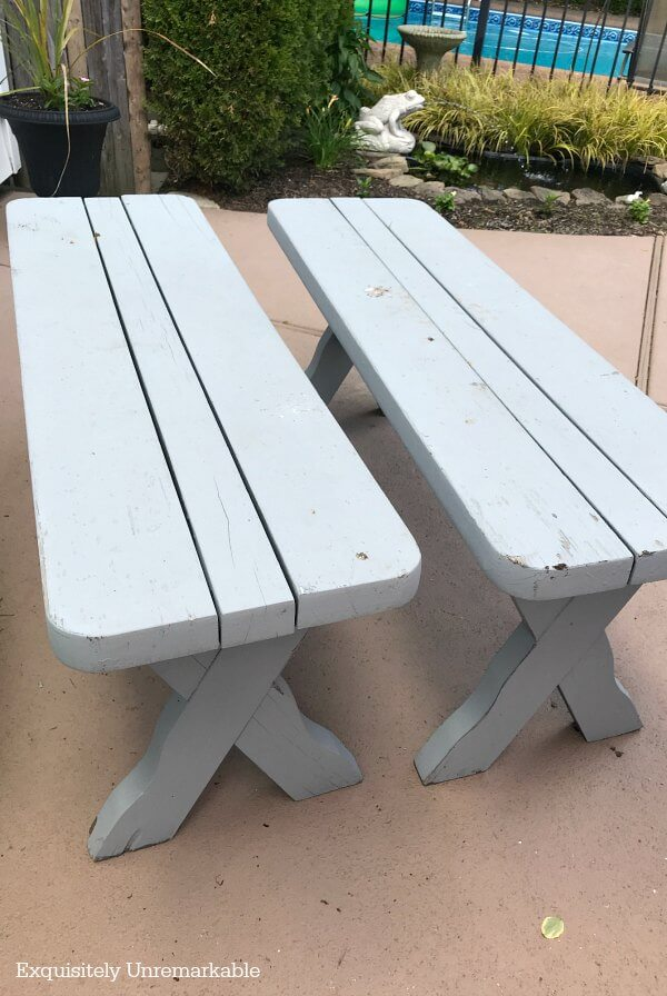 Two Weathered Wooden Picnic Benches