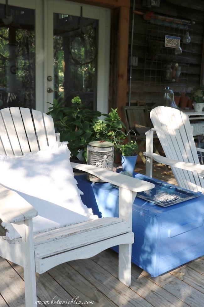 Raise a rustic blue box off the porch floor with paver stones