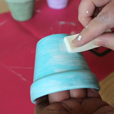 seal the project with mod podge to protect painted pots