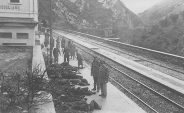 One of several graphic images from the Balvano Disaster shows the bodies of victims laid out on the station platform