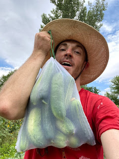 Man with Bag of Cucumbers