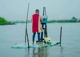 Pictures Of A YABATECH Student Drawing On Water Goes Viral