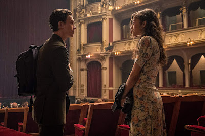 Spider-Man: Far from Home movie still where Peter Parker (Tom Holland) and MJ (Zendaya) meet up at an opera house on their summer school trip
