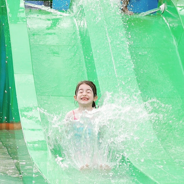 eldest sliding down the slide at the water park