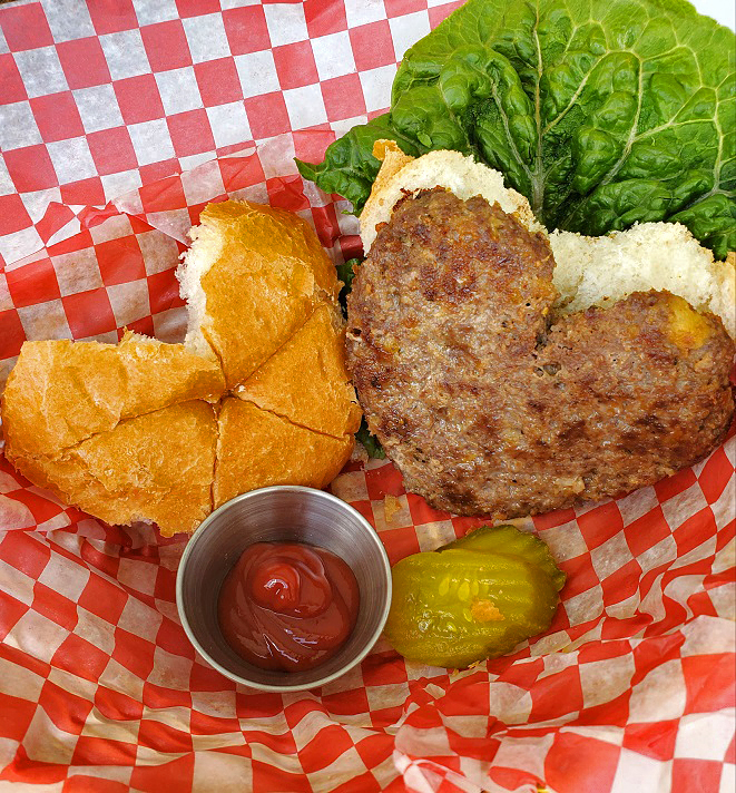 this is a heart shaped hamburger and heart shaped cut out bun to fit it on red and white checkerboard paper