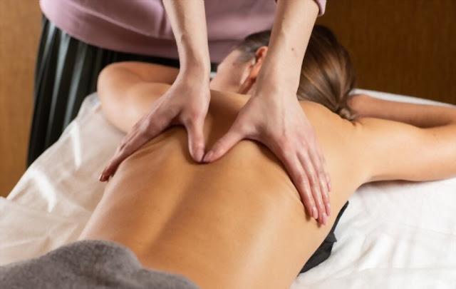 Relaxed young woman having Nuru body massage