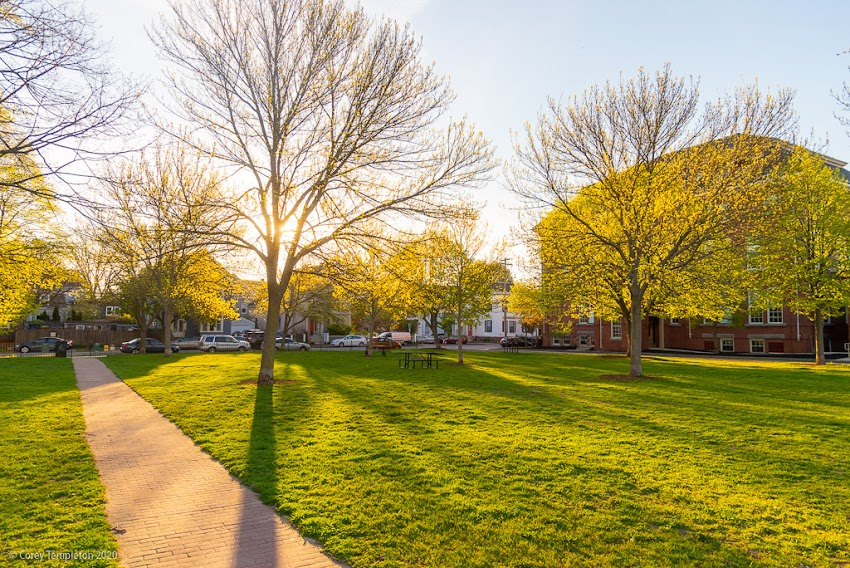 Portland, Maine USA May 2020 photo by Corey Templeton. A sunny morning in Fort Sumner Park. Looking back towards North Street instead of out towards the rest of the city.