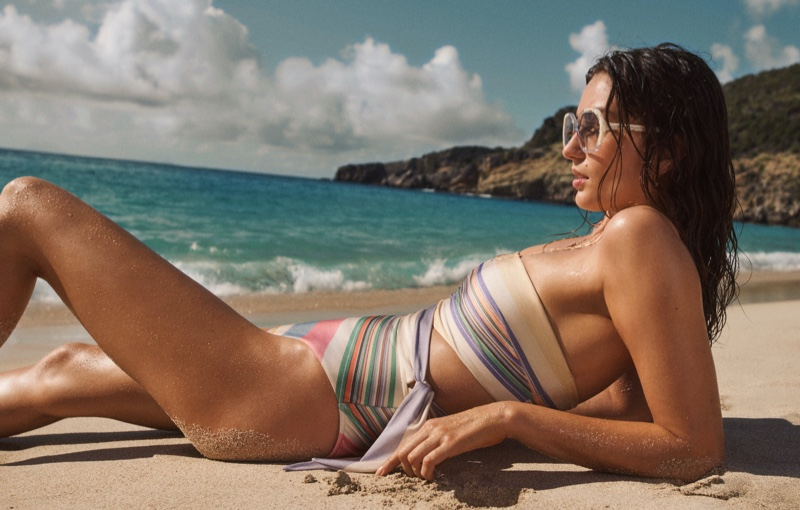 Zimmermann highlights Mae scarf tie one-piece and Botanic geo frame sunglasses in summer swim 2021 campaign.