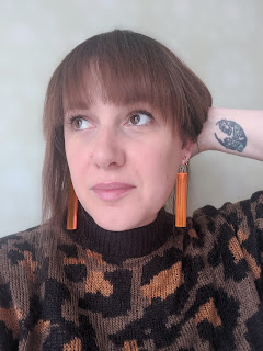 Lucy wearing neon orange perspex rod earrings by Wonderhaus