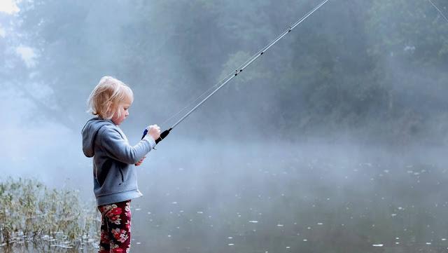 child fishing.Photo by Ben Wilkins on Unsplash