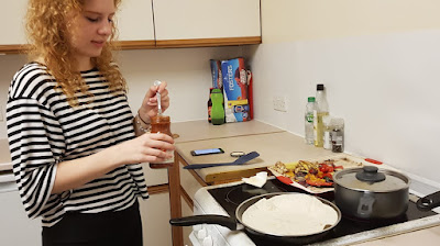 My daughter cooking in her own kitchen at university