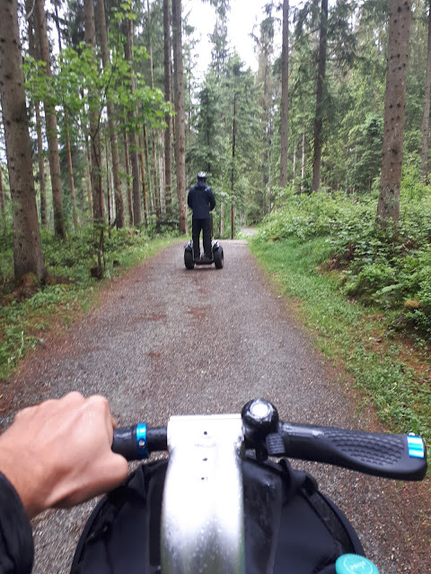 Bjorn Troch The Social Traveler riding a segway through the forest in Kitzbühel, Tyrol, Austria