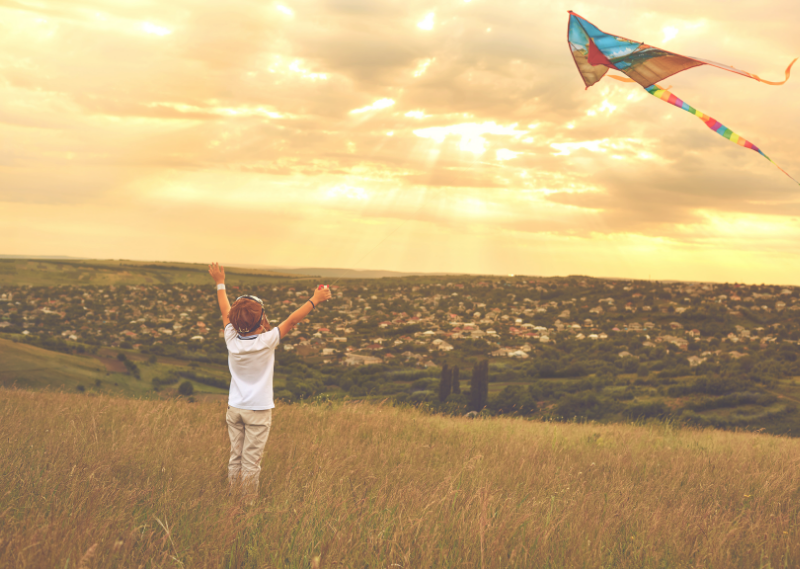 A child flying a kite in a blog post about 11 things I would tell my younger self.