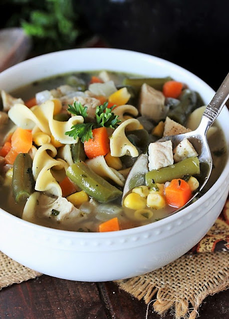 Bowl of Quick Turkey Noodle Soup with Spoon Image