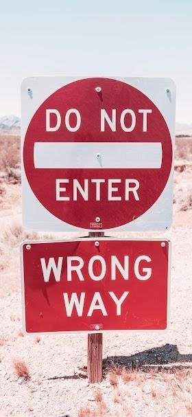 Red warning road sign wallpaper