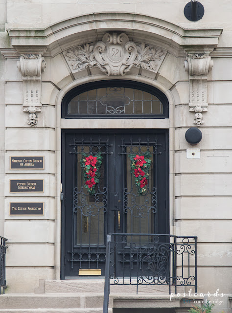 black front doors with Christmas swags