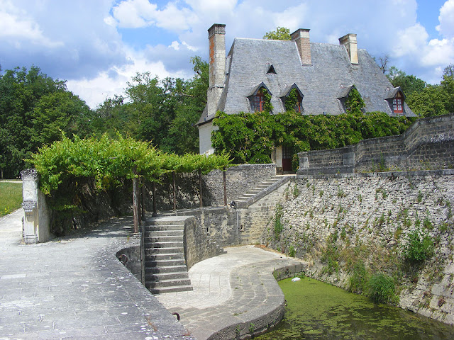 View of the estate manager's cottage from the quay at the Chateau of Chenonceau.  Indre et Loire, France. Photographed by Susan Walter. Tour the Loire Valley with a classic car and a private guide.