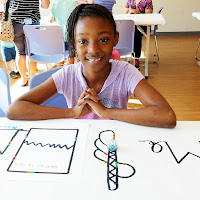 A child codes with an Ozobot