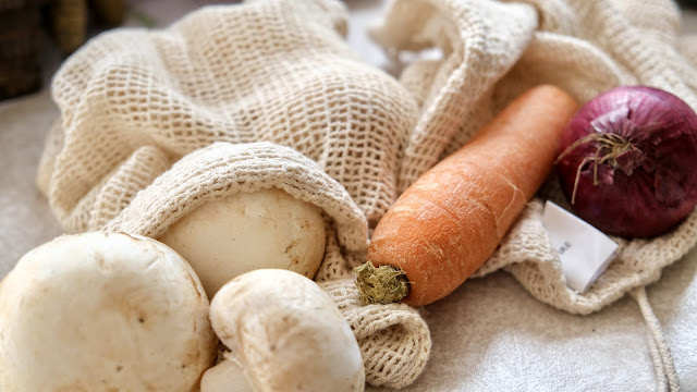 Produce bags with mushrooms, carrot and red onions