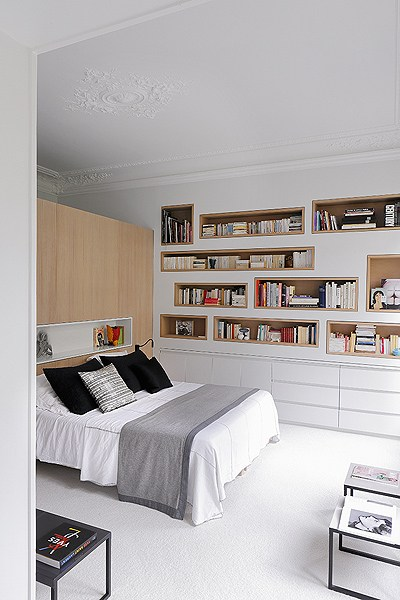 bedroom with recessed shelves