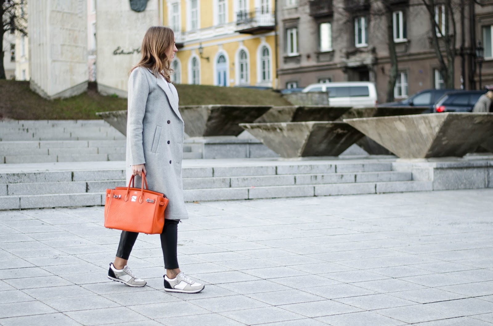 kristjaana mere winter black white gray outfit with orange hermes birkin bag