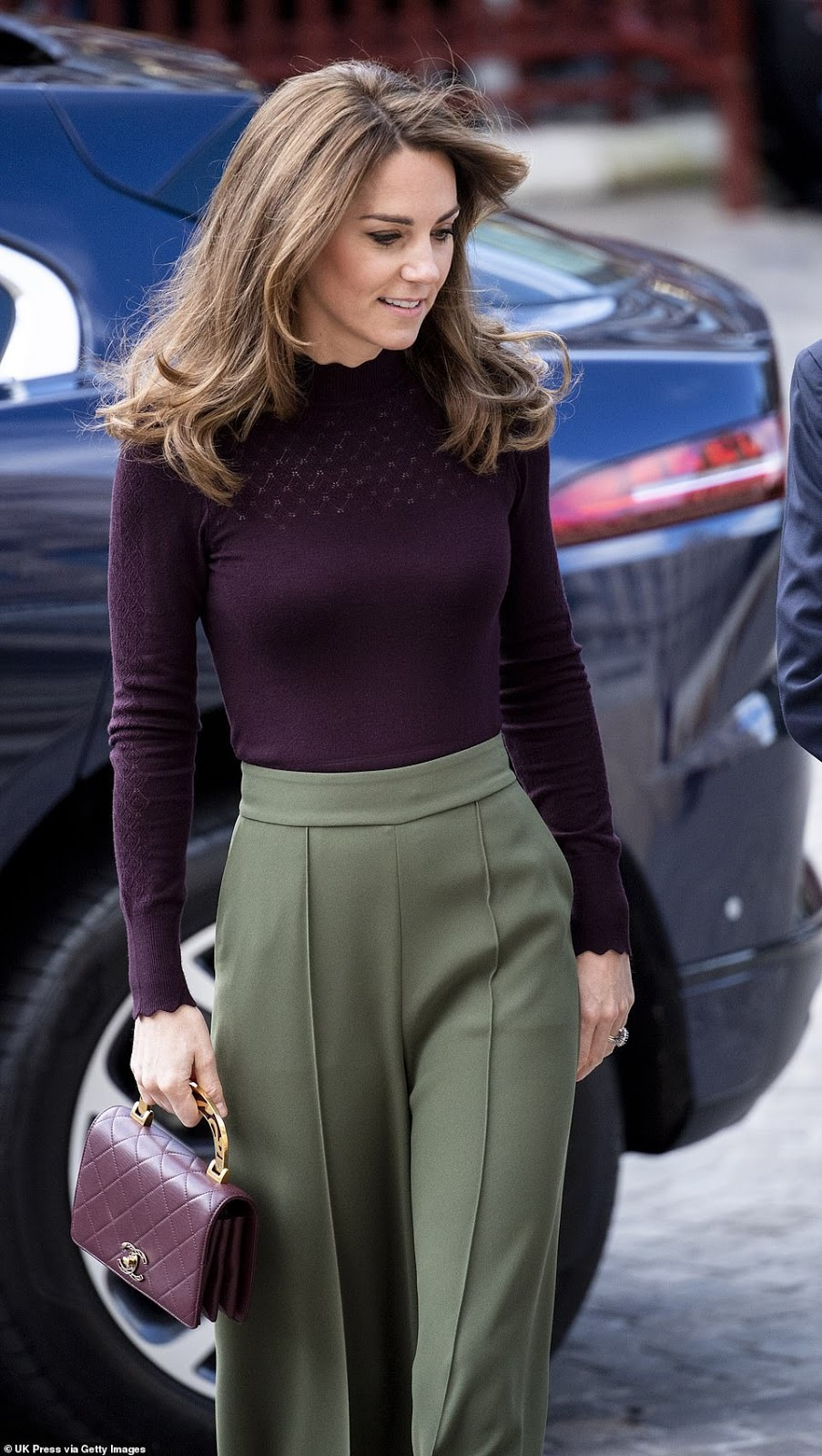Kate Middleton Carries a Chanel Bag While Wearing Wide-Leg Pants and a Knit Sweater