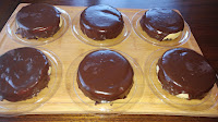 homemade kahlua used in mini cheesecakes, with chocolate crust and chocolate topping