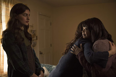 Diana Silvers watches as Octavia Spencer menacingly hugs her mom, played by Juliette Lewis, in the 2019 horror film Ma