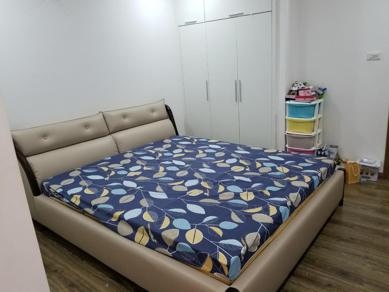 giường bọc nệm da