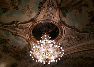 Ornate carved and painted ceiling with chandelier at the Opera House, Zürich, Switzerland