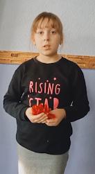 Чуйкр Вероника читает стихотворение Леси Украинки «Останні квіти»
