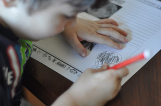 child drawing on notebooking page