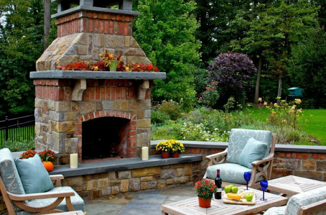 covered outdoor living spaces with fireplace