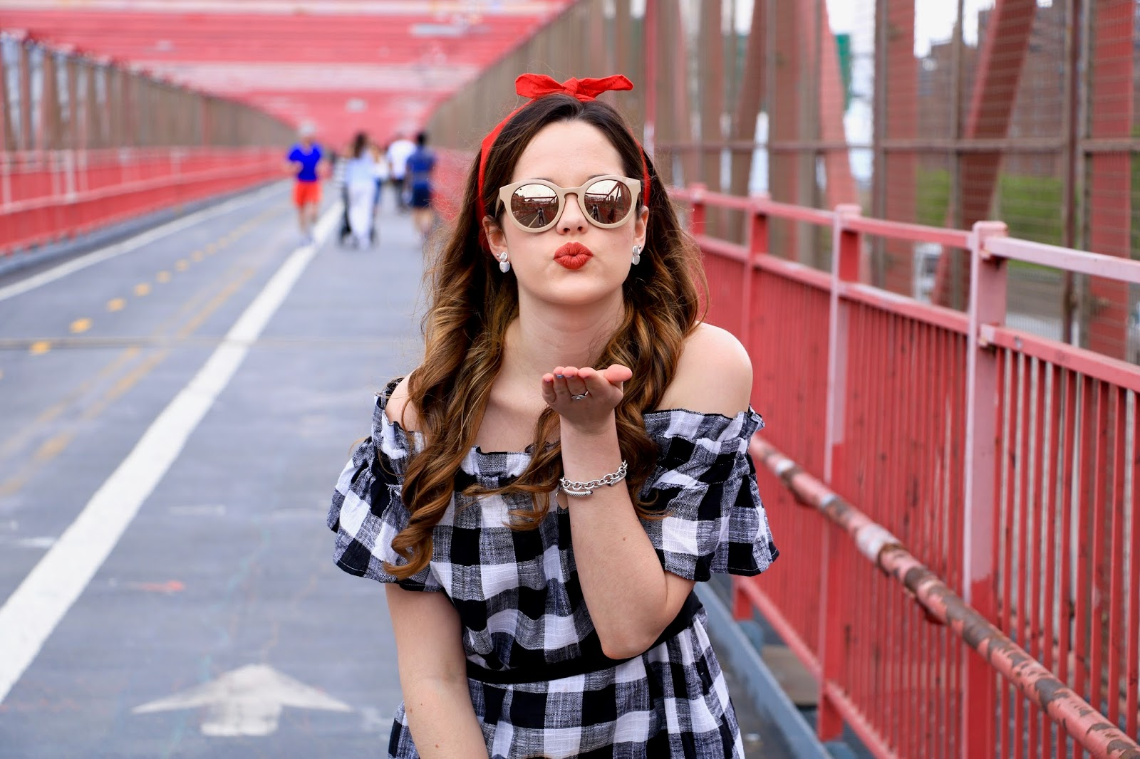 Fashion blogger Kathleen Harper in red bandana headband and off-the-shoulder dress