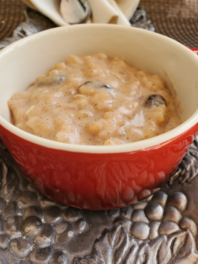 this is a red crock with raisins and homemade rice pudding in it
