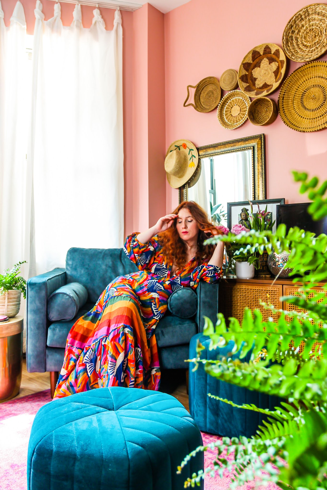 blue velvet chair // colorful homes // pink living room // farm rio maxi dresses // red head bloggers // home decor // maximalist // NYC apartments // colorful maximalist // small space homes // living room decor Ideas // colorful living room // pink and blue living room // basket wall