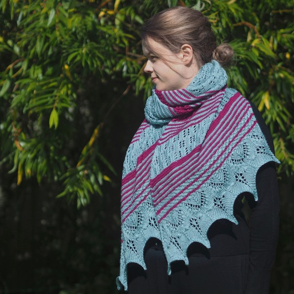 woman wearing a seafoam and magenta lace knitted wrap drapped around neck