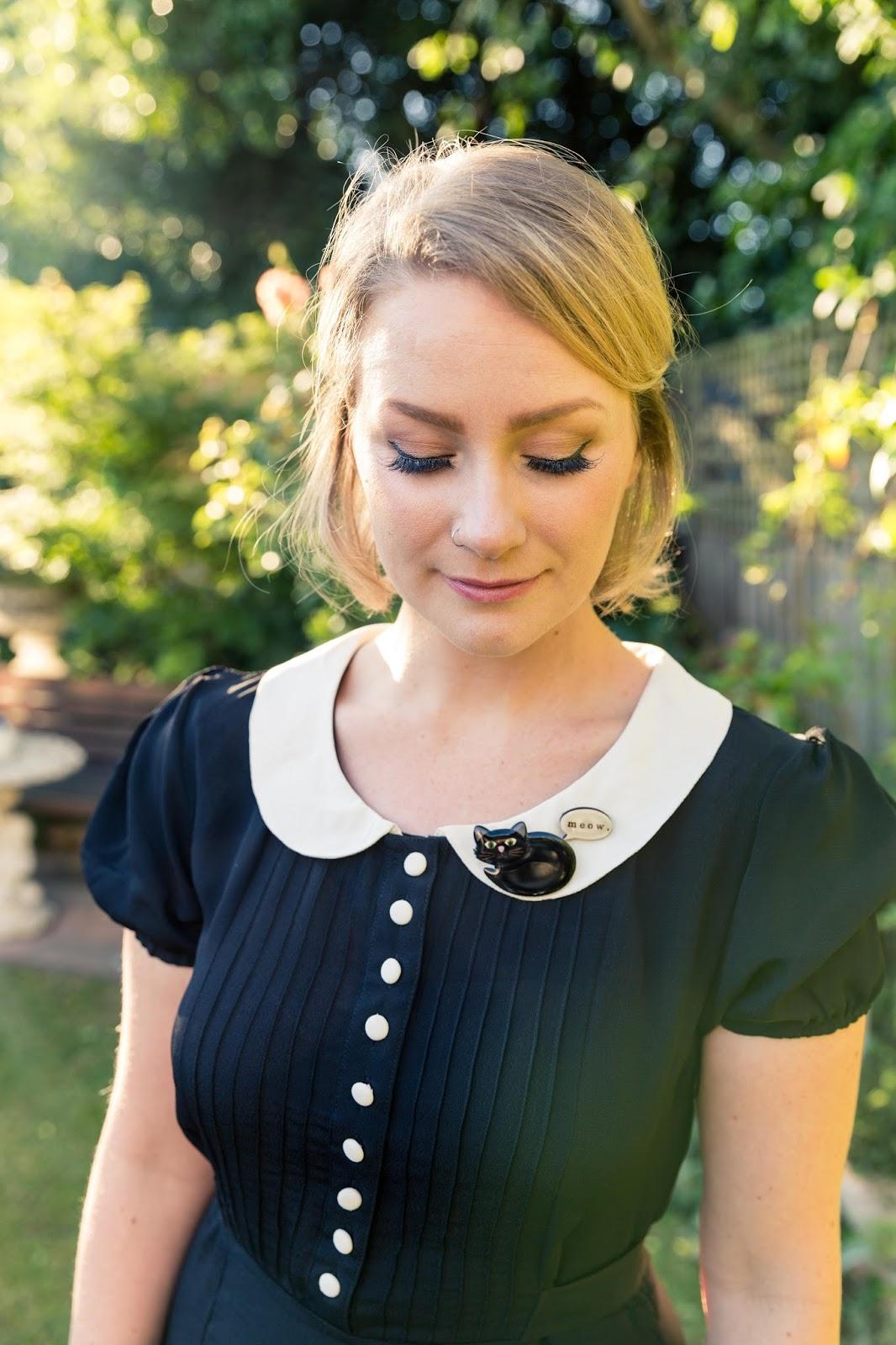 @findingfemme wears Seamstress of Bloomsbury black dress and Bok Bok B'Gerk cat brooch.