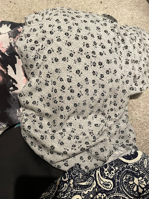 a piece of grey jersey with a small black floral print