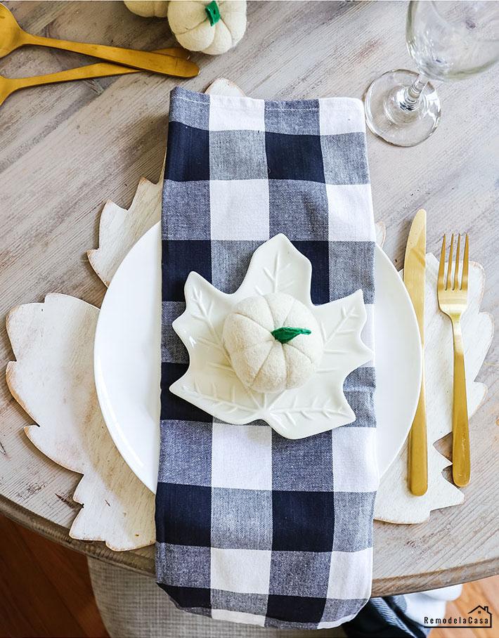 Black and white buffalo check napkins and leaf plates