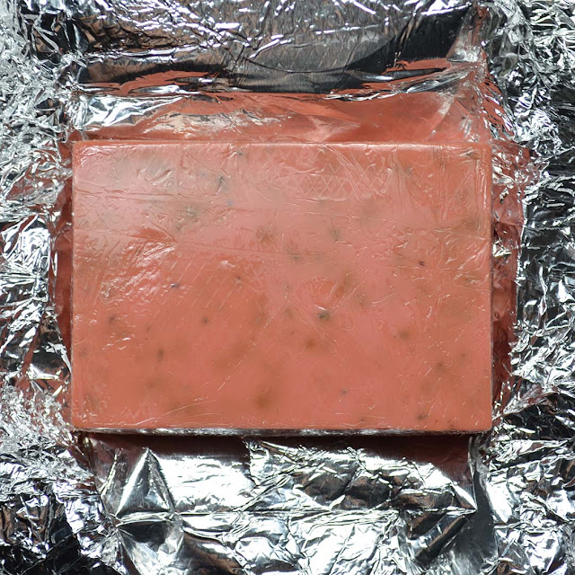 soap bar with rose buds on top of foil wrapping