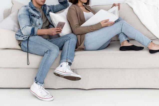 Couple sitting reading