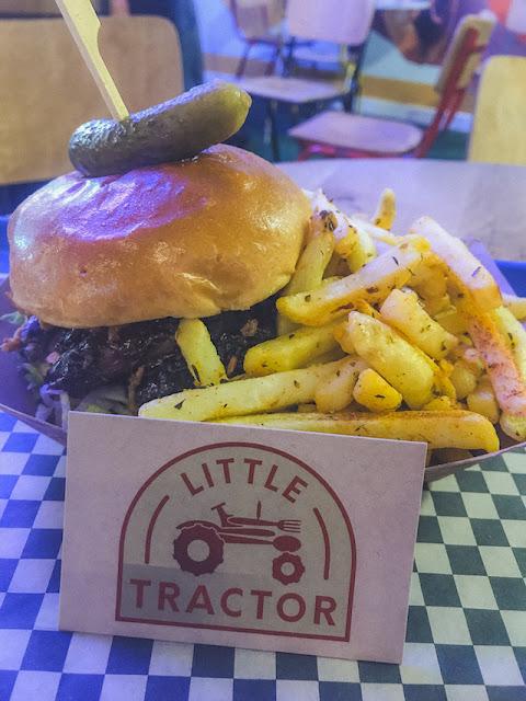 Trinity Kitchen Little Tractor beef brisket sandwich on tray