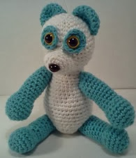 http://www.ravelry.com/patterns/library/evan-panda-amipal-amigurumi-stuffed-bear