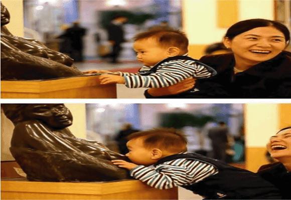 Criatividade-criança-mamando-estátua