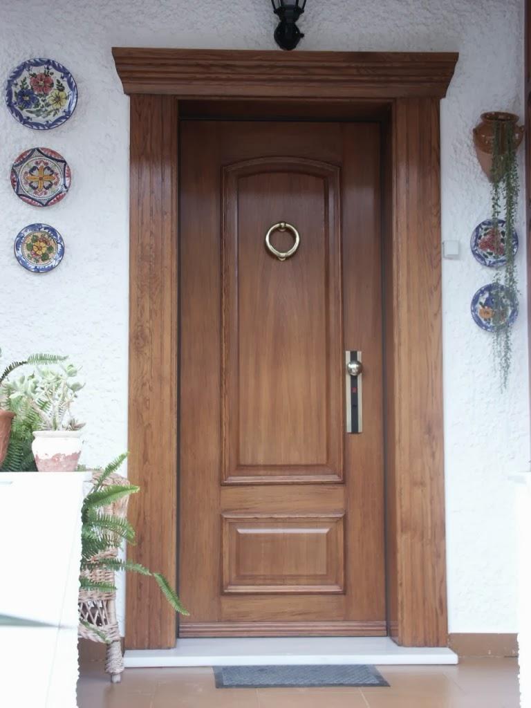 Puertas de madera exterior for Modelos de puertas de madera modernas para exteriores