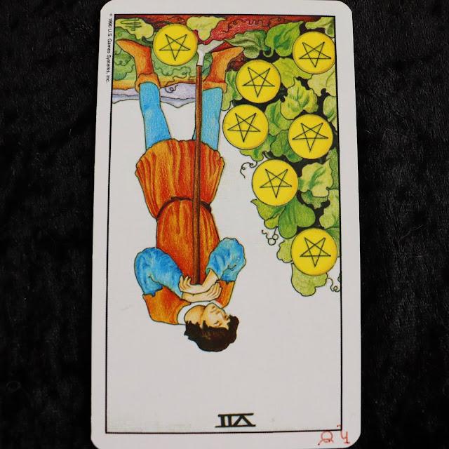 seven of pentacles reversed tarot card