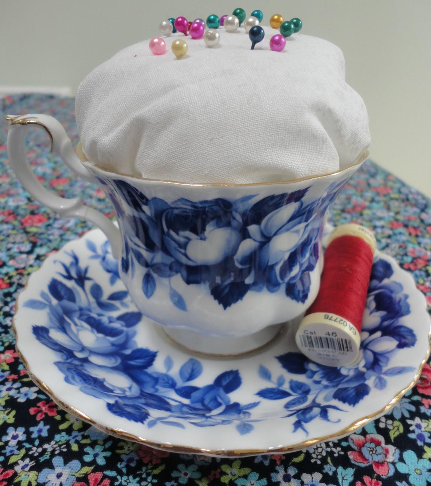 A vintage teacup pincushion